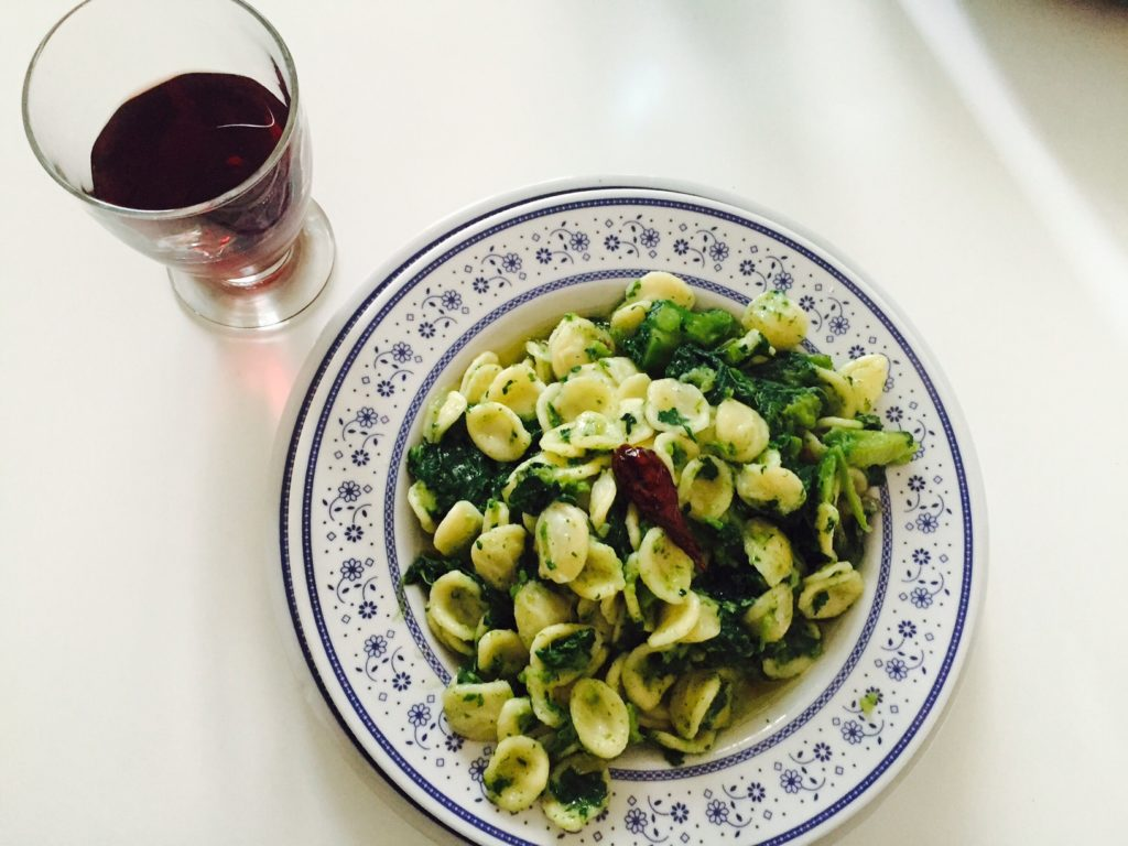 flatlay of bowl of pasta and glass of red wine from above - in my suitcase